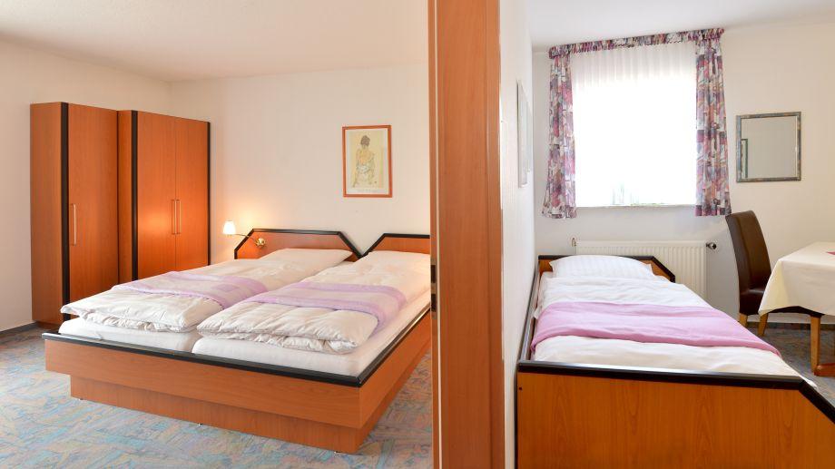 Das Mehrpersonenzimmer als Familienzimmer mit drei bis vier Betten